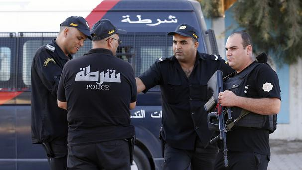 Tunisian police officers guard the street near the attacked Imperial Marhaba hotel in Sousse (AP)