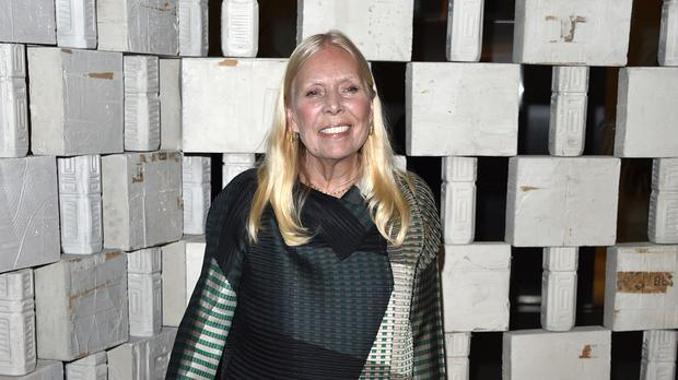 Joni Mitchell is recovering from an aneurysm at home and getting better each day, a friend has said (AP)