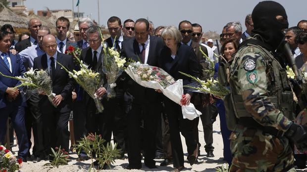 Senior European security officials, including the UK's Home Secretary Theresa May, pay their respects to the victims at the Mediterranean resort of Sousse (AP)