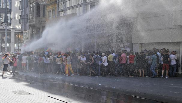 Turkish police use a water cannon to disperse participants at the Gay Pride event in Istanbul (AP)
