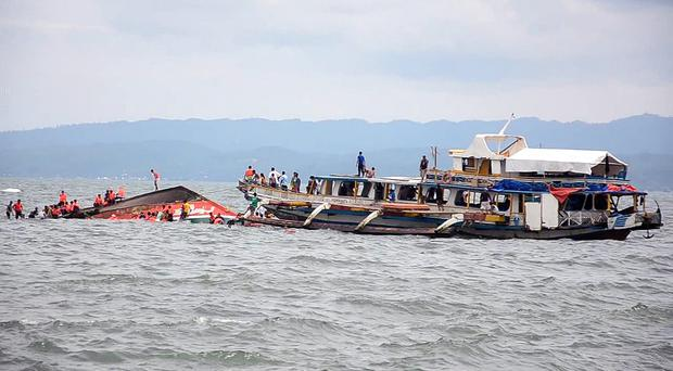 The MB Kim Nirvana overturned in choppy waters off Ormoc city. (AP)
