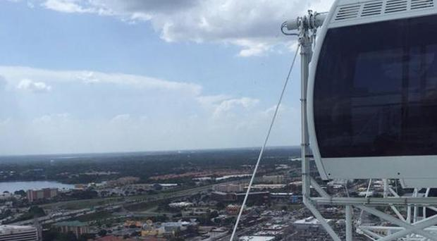 The 400ft Ferris wheel known as the Orlando Eye comes to a stop, stranding riders aboard (Makayla Bell/AP)