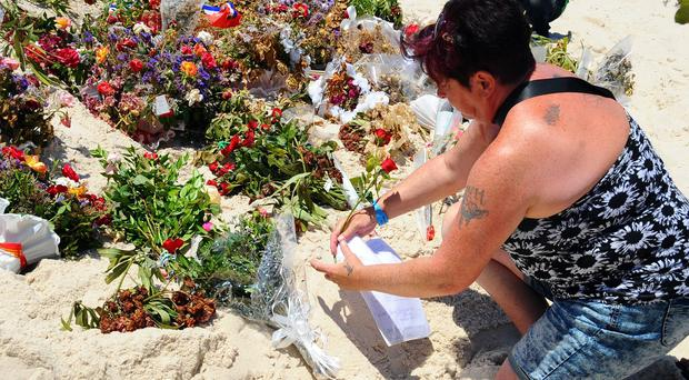 Tunisia's president has declared a state of emergency after the beach massacre (AP)