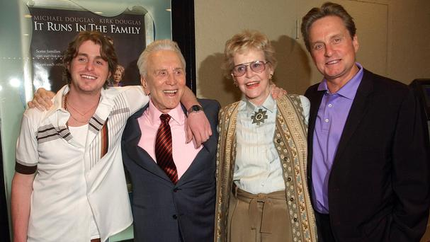 Kirk Douglas, second from left, with his ex-wife Diana, their son Michael Douglas, right, and Michael's son Cameron, left, in 2003 (AP)