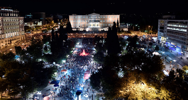 Crowds gather in front of the Greek Parliament in Athens last night as No voters celebrated their victory in the referendum