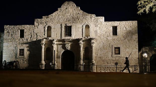 A pre-dawn memorial ceremony at the Alamo to remember the 1836 battle (AP)
