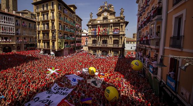 Revellers celebrate the official opening of the 2015 San Fermin fiestas in Pamplona, Spain (AP)