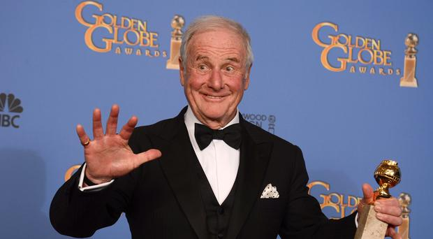 Jerry Weintraub pictured with his Golden Globe for best mini-series or motion picture made for television for Behind the Candelabra (AP)