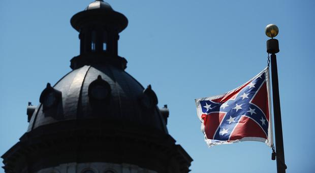 The Confederate flag flies near the South Carolina statehouse in Columbia (AP)