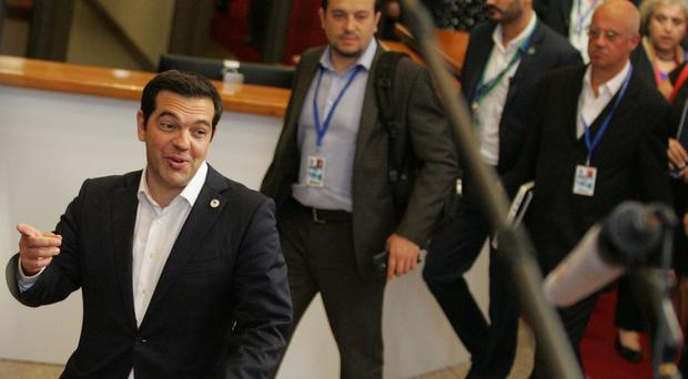 Greek prime minister Alexis Tsipras leaves after an emergency summit of eurozone heads of state and government in Brussels (AP)