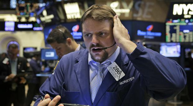 Traders work on the floor at the New York Stock Exchange (AP)