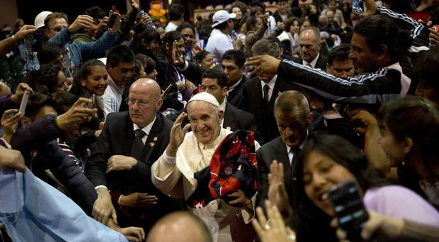 Pope Francis walks amid the crowd while leaving the second World Meeting of Popular Movements in Santa Cruz, Bolivia (AP)