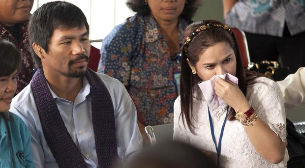 Manny Pacquiao and his wife at Wirogunan Prison in Yogyakarta, Indonesia. (AP)