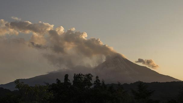 Smoke and ash rise from the Colima volcano, also known as the Volcano of Fire, near the town of Comala, Mexico (AP Photo/Sergio Tapiro Velasco)