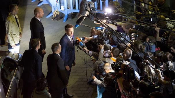 Eurogroup president Jeroen Dijsselbloem speaks with the media as he leaves after a meeting of eurozone finance ministers in Brussels (AP)