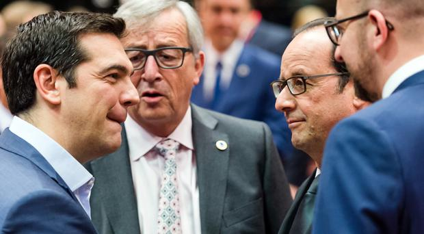 Greek PM Alexis Tsipras speaks to Jean-Claude Juncker, Francois Hollande and Charles Michel during a meeting of eurozone leaders in Brussels (AP)