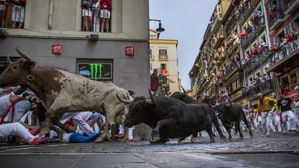 Two people were hurt during the second last day of the running of the bulls at the famous San Fermin festival in Pamplona, Spain (AP)