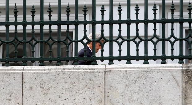 US secretary of state John Kerry walks in the garden of Palais Coburg where closed-door nuclear talks with Iran were taking place in Vienna, Austria (AP)