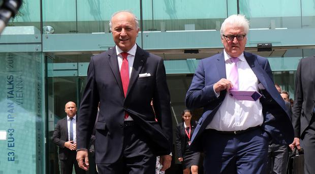 French foreign minister Laurent Fabius and German foreign minister Frank-Walter Steinmeier arrive for a press briefing on nuclear talks with Iran in Vienna, Austria (AP)