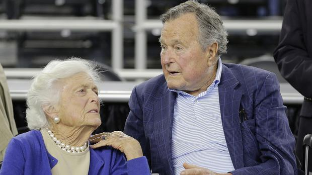 George HW Bush and his wife Barbara pictured in March (AP)