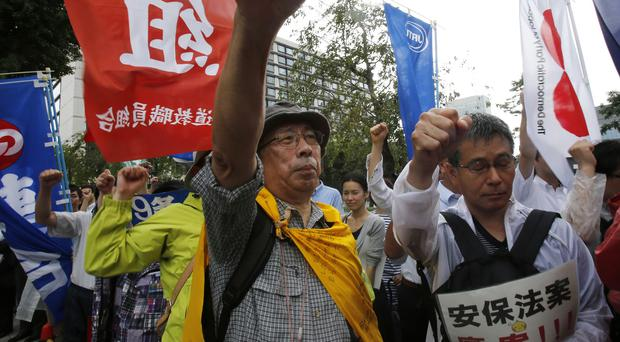 Anti-war protesters in Tokyo during a rally after Japan's lower house of parliament approved legislation that would expand the role of the nation's military. (AP)