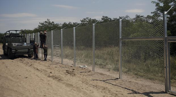 Hungarian soldiers build a fence near Morahalom. (AP)