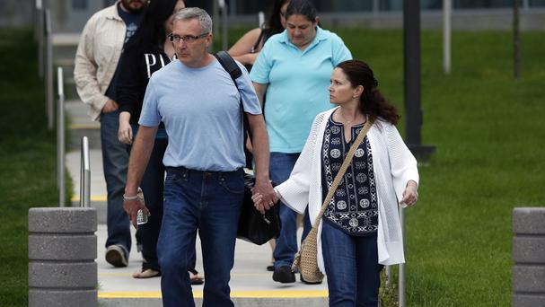 Tom Teves and his wife Karen, whose son Alex was killed in the 2012 Aurora cinema massacre, leave Arapahoe County District Court in Centennial, Colorado, after closing arguments in the trial of James Holmes (AP Photo/Brennan Linsley)