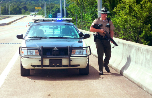 A police officer patrols the scene in Tennessee