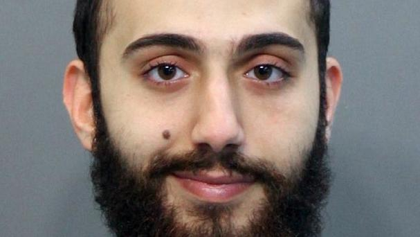 A man identified as suspected Chattanooga gunman Muhammad Youssduf Adbulazeer is pictured after being detained for a driving offence in April (Hamilton County Sheriffs Office/AP)