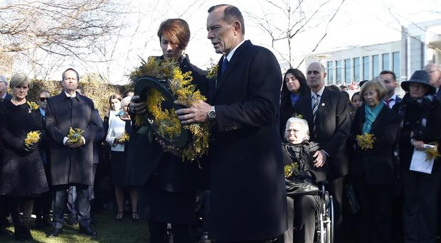 Prime minister Tony Abbott and his wife Margaret prepare to lay a wreath for the Australian victims of Malaysia Airlines jet MH17 (AP)