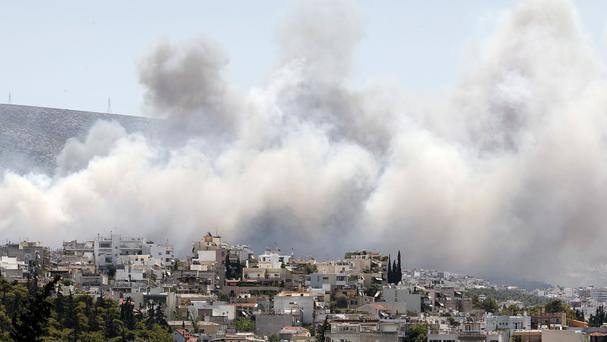 Smoke from a fire over the eastern suburbs of Athens. (AP)