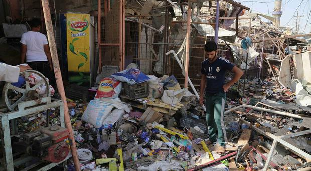 The scene of a suicide car bombing at a busy market in Diyala province (AP)