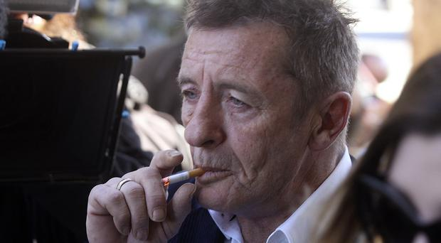 AC/DC drummer Phil Rudd has been bailed after his arrest for allegedly breaching the terms of his home detention sentence (New Zealand Herald/AP)