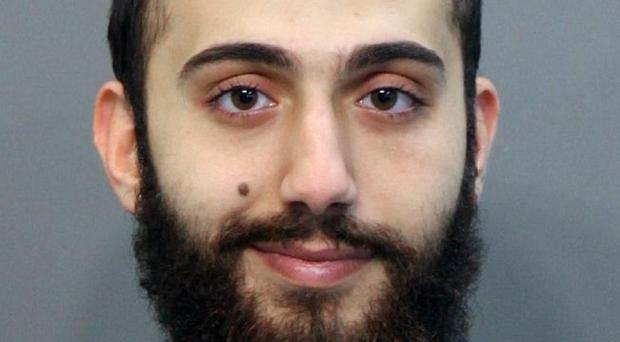 A police photo of Mohammad Youssduf Adbulazeer after he was detained in April for a driving offence (Hamilton County Sheriffs Office/AP)