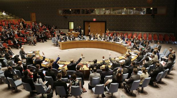 The UN Security Council votes in favour of a resolution approving Iran's nuclear deal (AP)