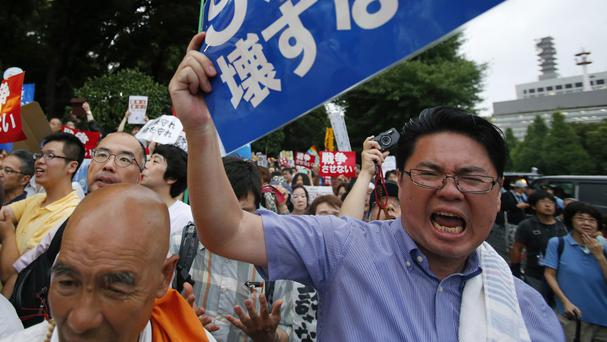 An anti-war protester during a rally outside the parliament building in Tokyo (AP)