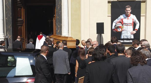 Pallbearers carry the coffin of French Formula One driver Jules Bianchi into Sainte Reparate Cathedral during his funeral in Nice (AP)