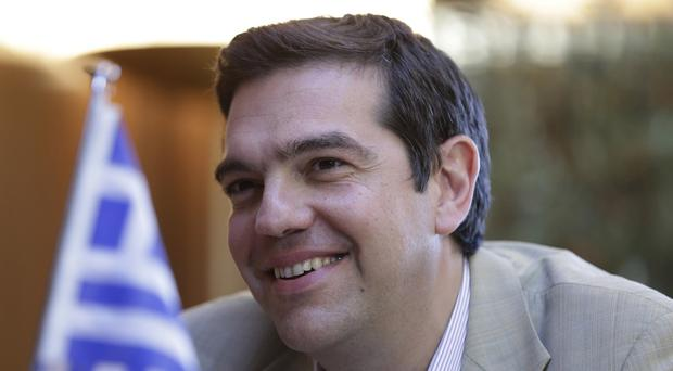 Greece's Prime Minister Alexis Tsipras is seeking parliamentary support for bailout reforms (AP)
