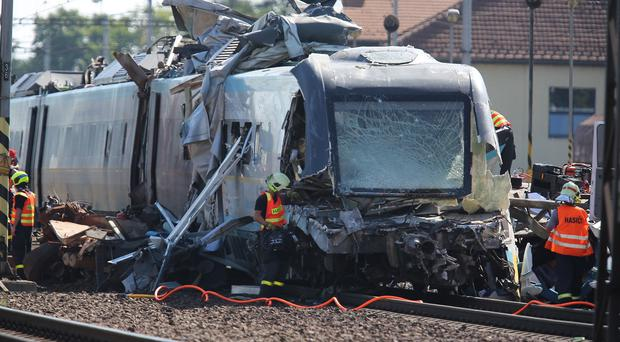 Rescue workers at the scene of a collision between a high-speed train and a truck in the city of Studenka (AP)