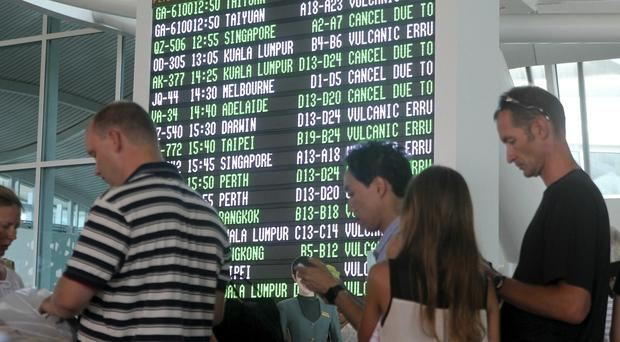 Passengers wait for the status of their flights at Ngurah Rai International Airport in Bali, Indonesia, after a series of volcanic eruptions (AP)
