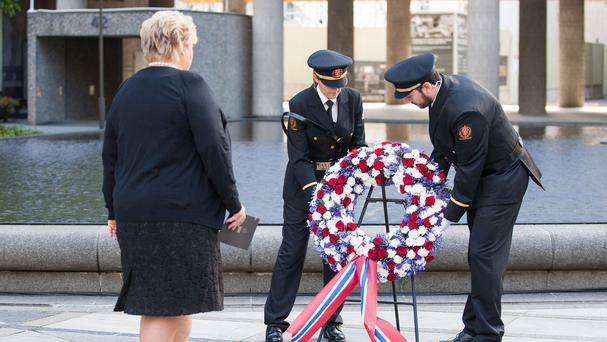Norwegian PM Erna Solberg takes part in a wreath-laying ceremony remembering the victims of the attacks in 2011 (AP)