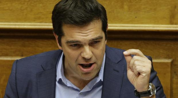 Greece's Prime Minister Alexis Tsipras delivers a speech during an emergency parliament session in Athens (AP)