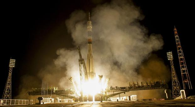 The Soyuz-FG booster rocket with the space capsule Soyuz TMA-14M is launched from the Baikonur cosmodrome, Kazakhstan (AP)