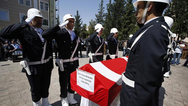 The funerals of two police officers killed on Wednesday have taken place in Turkey (AP)