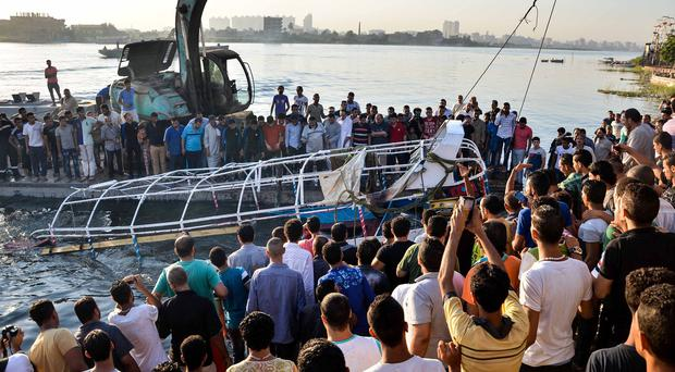 The passenger boat is hauled to the surface on the Nile, Egypt (AP)