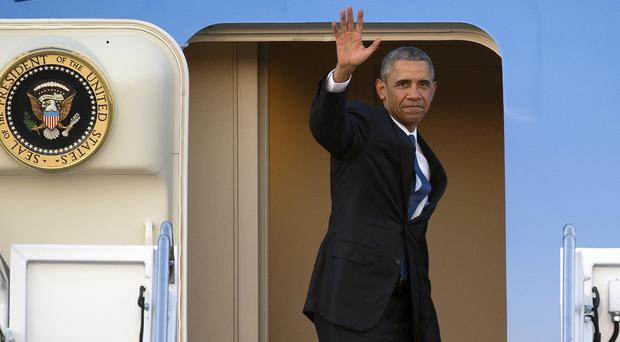 President Barack Obama waves as he boards Air Force One for a trip to Kenya and Ethiopia (AP)