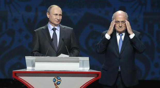 Fifa president Sepp Blatter and Russian president Vladimir Putin took centre stage at the draw (AP)