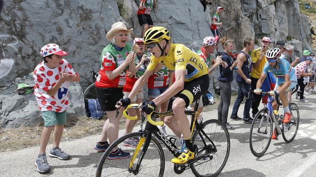 Britain's Chris Froome, wearing the overall leader's yellow jersey, is still in pole position to win the Tour de France