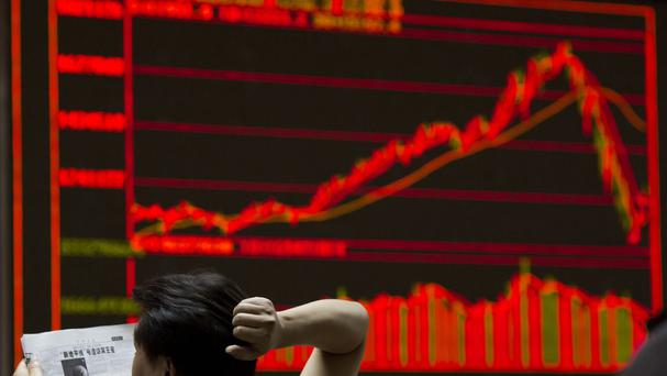The Shanghai Composite closed down 8.5% at 3,725.56. (AP)
