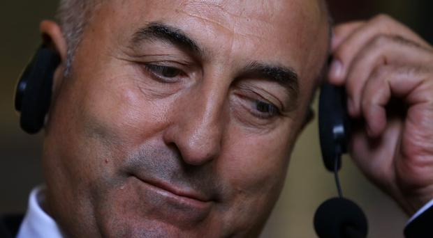 Turkish foreign minister Mevlut Cavusoglu has refused to draw a distinction between the Islamic State group and the PKK. (AP)